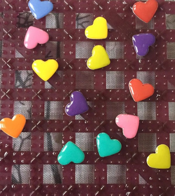 resin applied to paper hearts