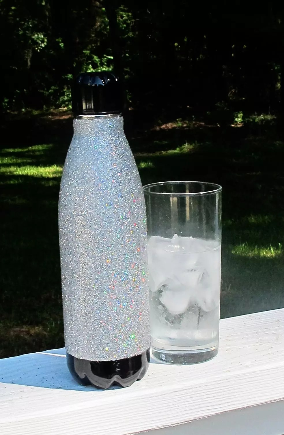 stainless steel tumbler covered with glitter and resin