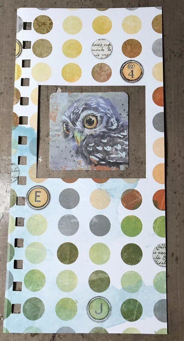 scrapbook paper and owl art waiting for resin