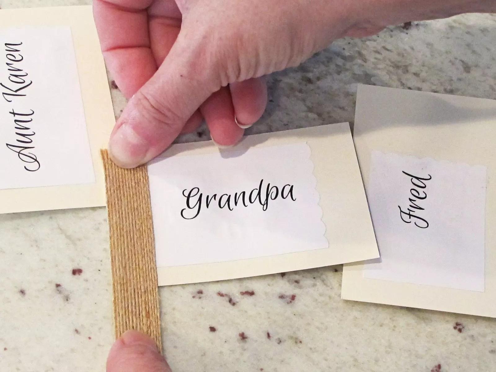applying burlap ribbon to a name card