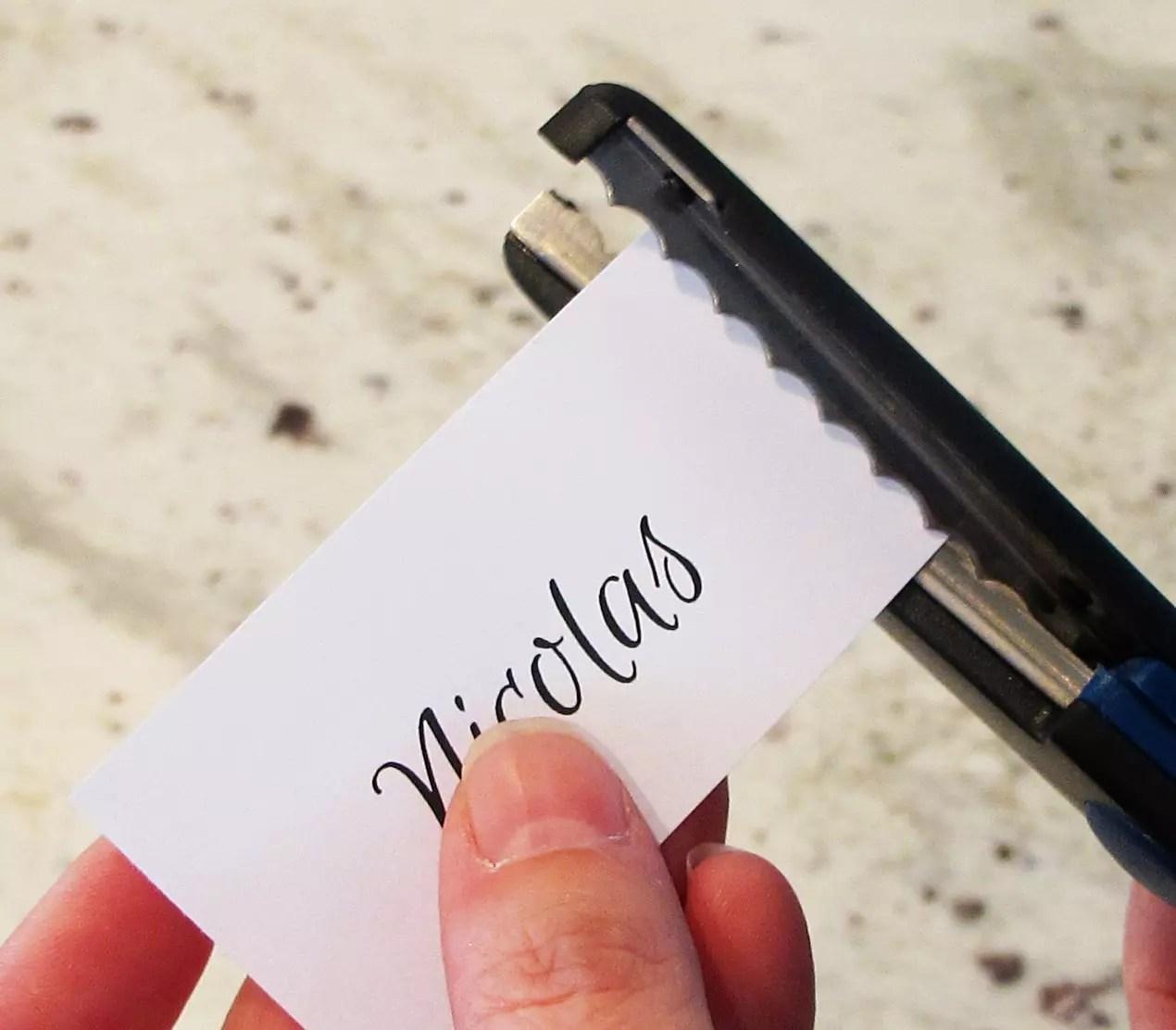 trimming paper with decorative scissors