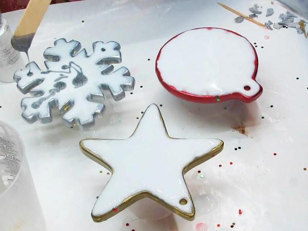 adding colored resin to Christmas ornaments