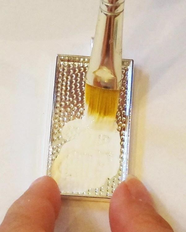 adding glue to a pendant