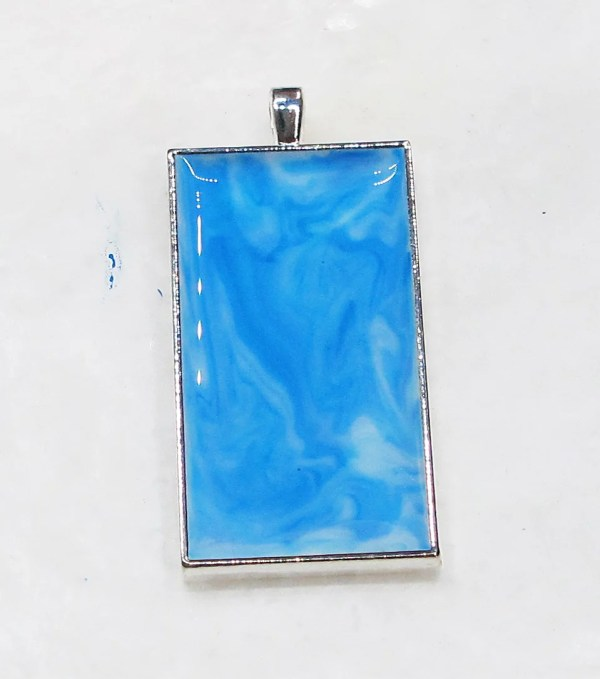 marbled blue resin background in pendant