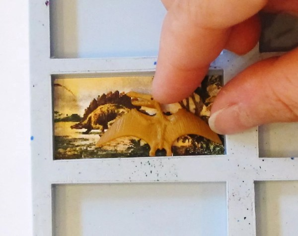 fitting dinosaur and clip art into mold