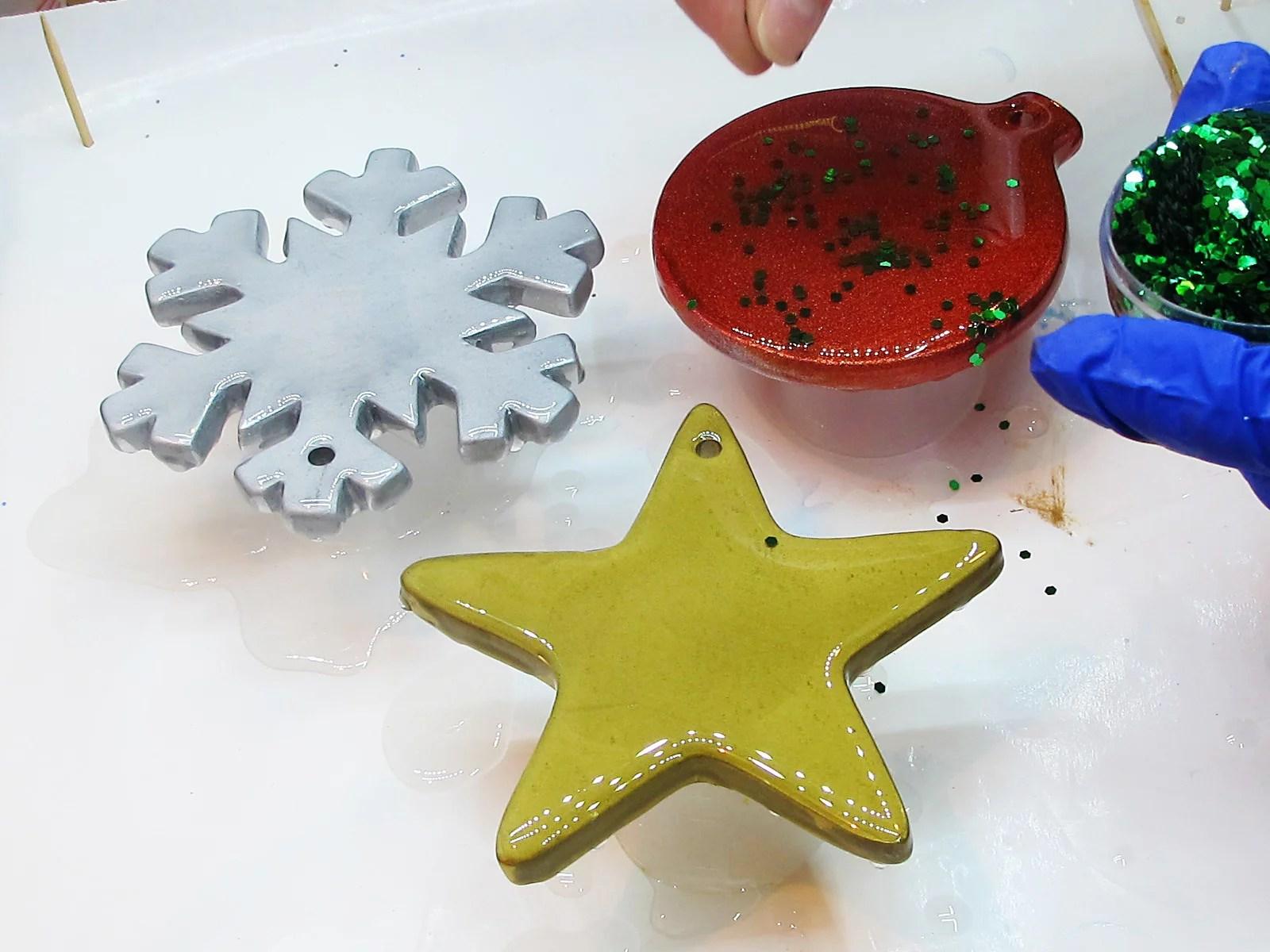 adding glitter to resin ornaments