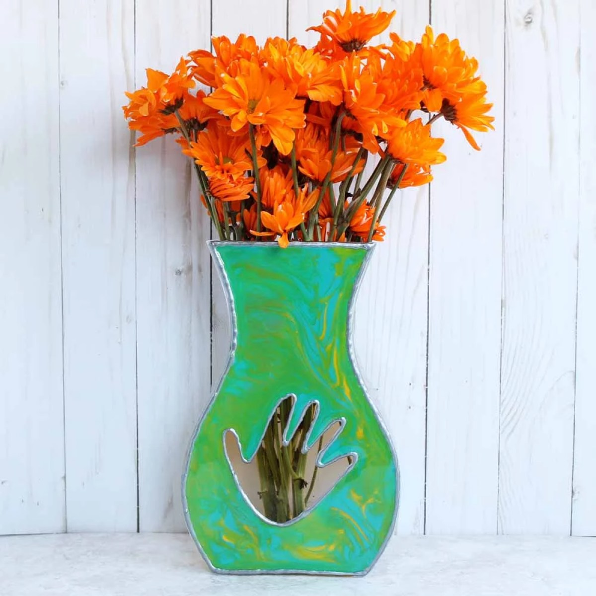 resin painted flat sided vase with child's handprint and flowers