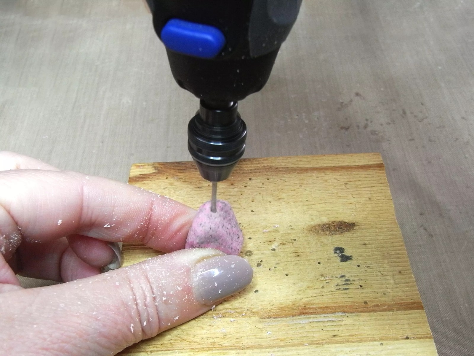 drilling a hole into resin pebble