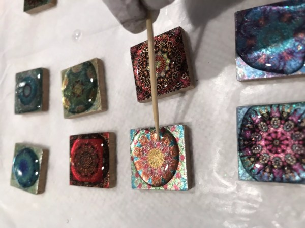 coating mandala pendants with resin