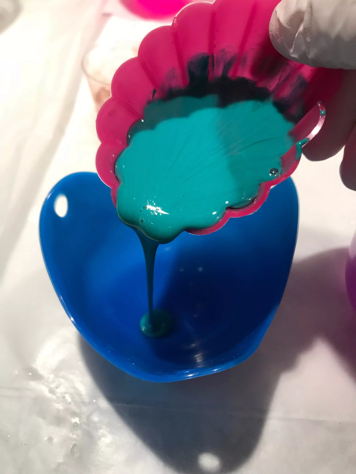 pouring resin into mold
