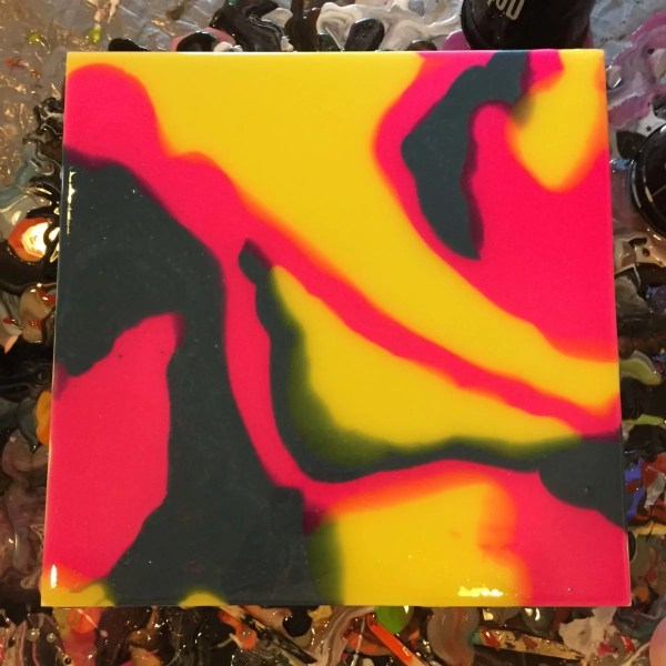 Pink yellow blue resin on a tile