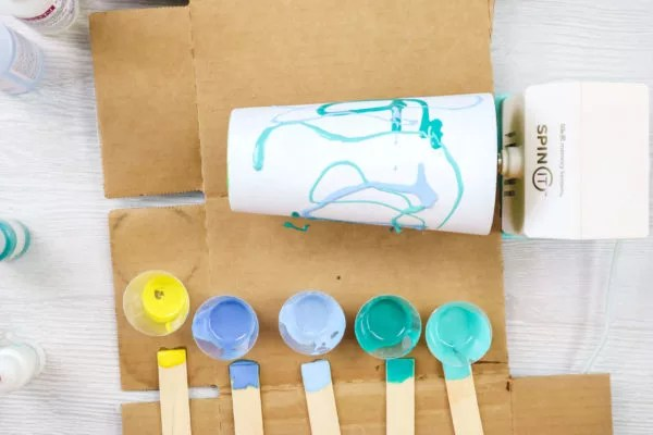 applying colored resin to a stainless steel tumbler
