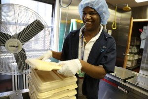 Project SEARCH intern Anthony Telesford is all smiles while working in the kitchen at Montefiore New Rochelle