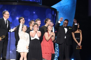 Born This Way cast and producers celebrating their Emmy win on stage at the Emmy Awards. Executive Producer Jonathan Murray holds the Emmy Award.