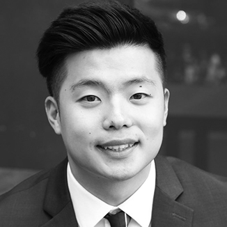 headshot of DH Lee with gelled hair grayscale photo