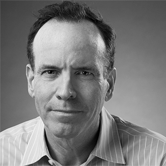 Headshot of Jonathan Murray wearing a striped shirt and facing the camera grayscale photo