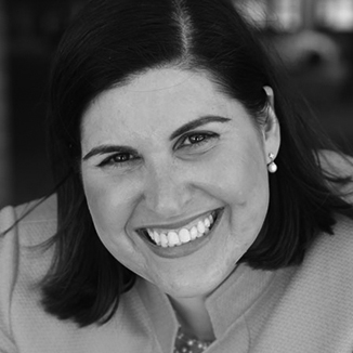 headshot of Lauren Appelbaum smiling and wearing a blazer grayscale photo