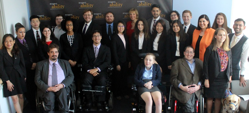 Randy Duchesneau and RespectAbility Fellows standing and seated in a posed photograph, smiling for the camera