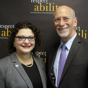 RespectAbility Fellow Emma Adelman and Patrick McCarthy posing and smiling for a photo