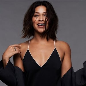 Gina Rodriguez wearing a black dress, smiling