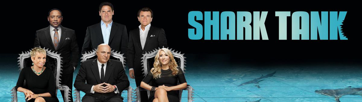 "Shark Tank promo photo showing six main sharks seated and standing above a shark tank with the words ""Shark Tank"""
