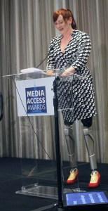 Katy Sullivan presenting the award - prosthetic legs are visible