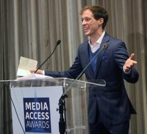 Mickey Rowe accepting his Media Access scholarship award