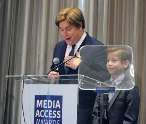 Stephen Chbosky and Jacob Tremblay announcing an award for David Hoberman and Todd Lieberman
