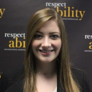 RespectAbility fellow Richelle Ross smiling in front of the RespectAbility banner