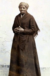 Harriet Tubman standing and posing for a picture wearing a long dress
