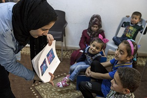 Children take part in formative research conducted by Sesame Workshop and International Rescue Committee at a women's center in Mafraq, Jordan, in May 2017.