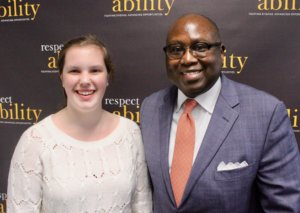 Rodney Hood and RespectAbility Fellow Emily Counts in front of the RespectAbility banner