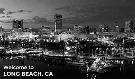 "Photo of downtown Long Beach at night with the text ""Welcome to Long Beach, CA"" in the bottom left."