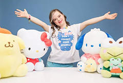 Megan Bomgaars in the middle of four dolls from Sanrio