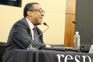 Clarence Page speaking into a microphone at RespectAbility's intersectionality panel