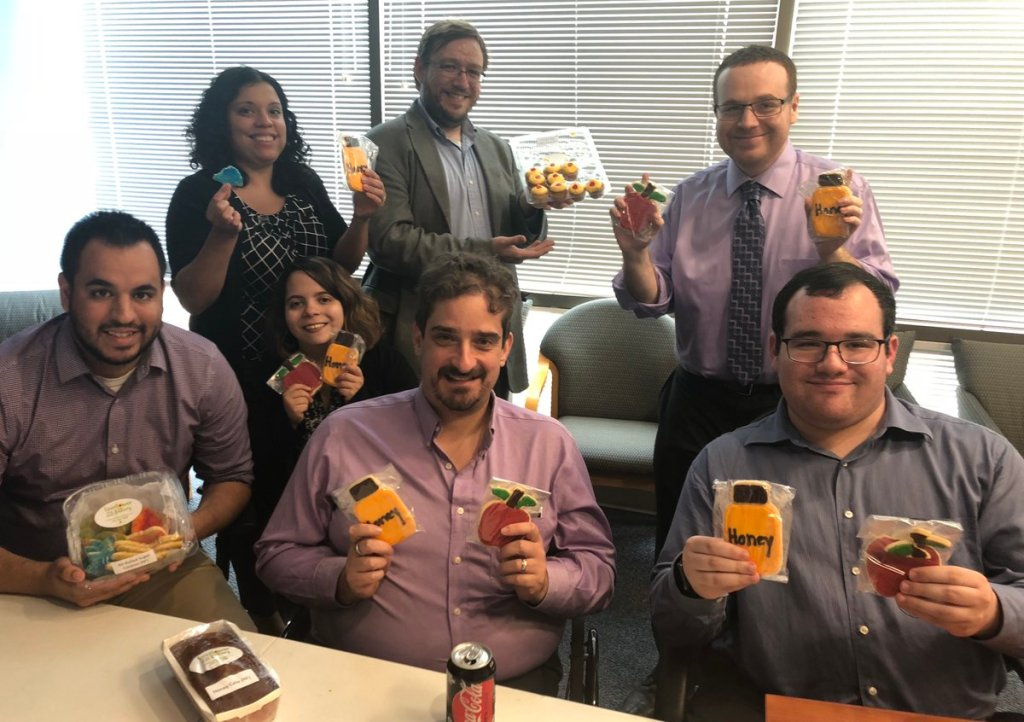 RespectAbility staff and Fellows celebrating Rosh Hashanah with cookies from Sunflower Bakery