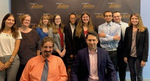 Geoffrey Melada and RespectAbility staff and Fellows in front of the RespectAbility banner