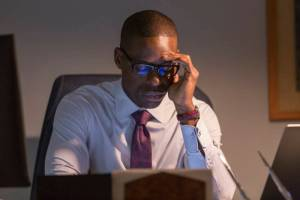 Sterling K. Brown as Randall on This Is Us looking worried staring at a computer screen