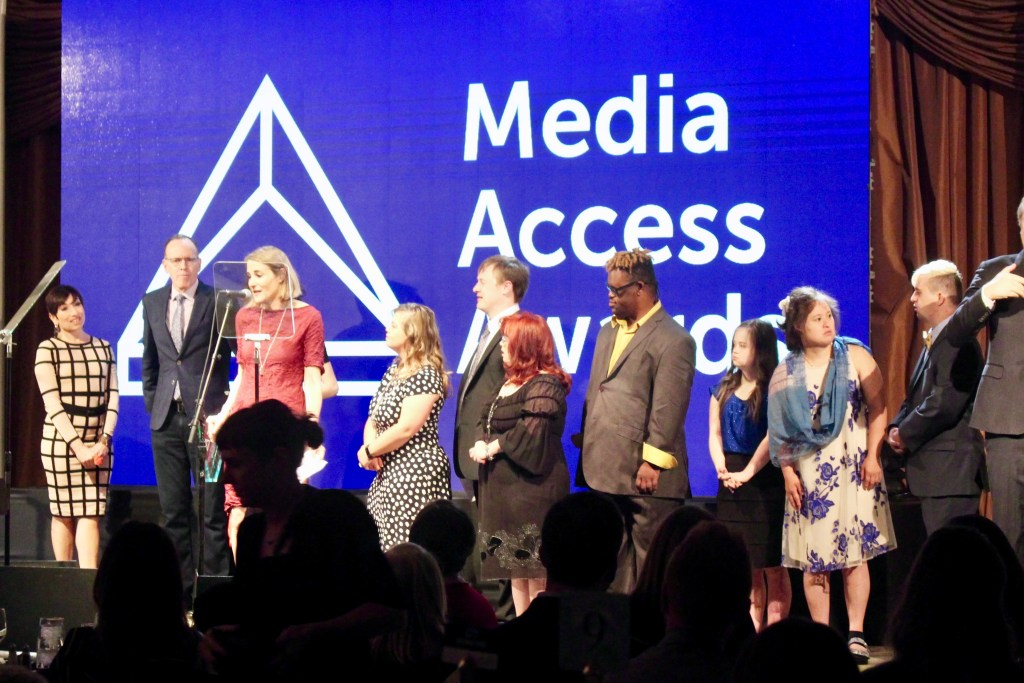 Jonathan Murray and the Born This Way cast present an award to Sasha Alpert and Megan Sleeper at the Media Access Awards 2018
