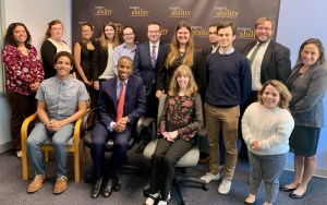 Speakers from the Senate Democratic Diversity Initiative with RespectAbility staff and Fellows in front of the RespectAbility banner