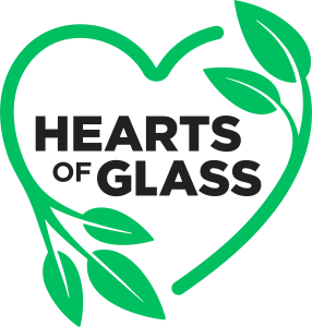 Hearts of Glass Logo, with green plants shaped like a heart surrounding text reading Hearts of Glass