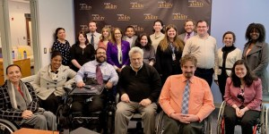 Steve Rabinowitz with RespectAbility Staff and Fellows in front of the RespectAbility banner