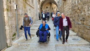 A wheelchair user tries out the newly accessible streets in Jerusalem's Old City, part of a NIS 20 million ($5.5 million) project along four kilometers of Old City streets
