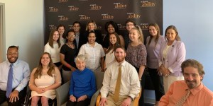 Eleanor Clift with RespectAbility staff and Summer 2019 Fellows smiling in front of the RespectAbility banner
