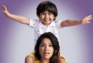 Gina Rodriguez as Jane The Virgin with her son Mateo (played by Elias Janssen) on her back