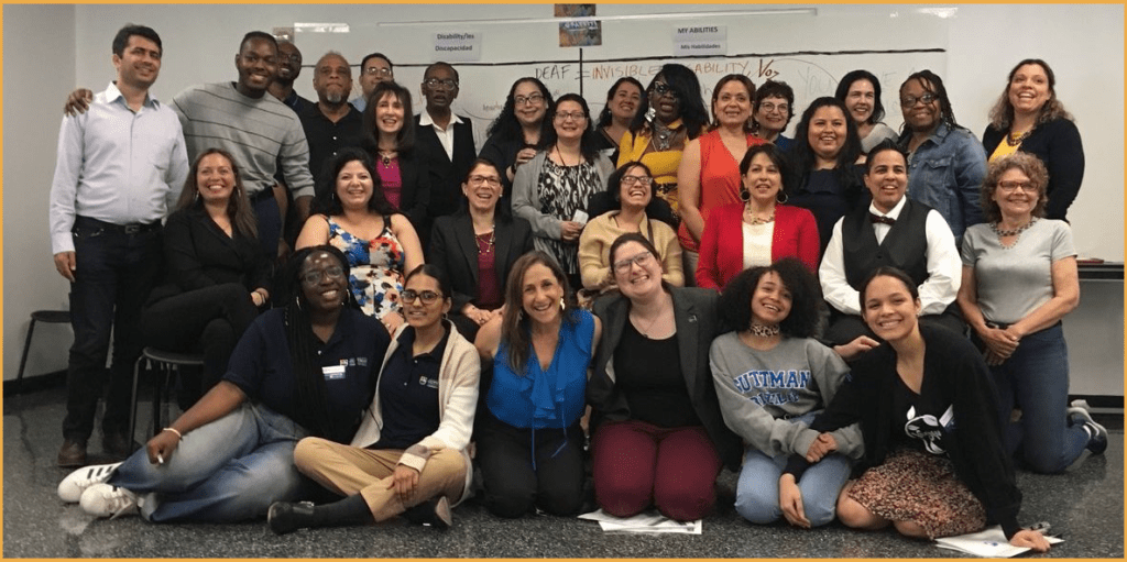 Attendees at training for latinas with disabilities smiling together