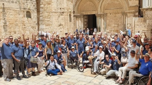 Attendees at Access Israel's conference together outside the Holy site in Jerusalem, many of them wheelchair users.