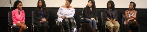 Six women of color with disabilities at the Women of Color Disability Summit on stage together in the middle of a discussion