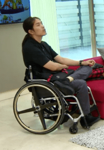 Pao, who is a wheelchair user, inside a living room on The Real World Thailand