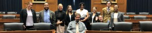 RespectAbility Summer 2019 Fellows smile together inside a Capitol Hill hearing room